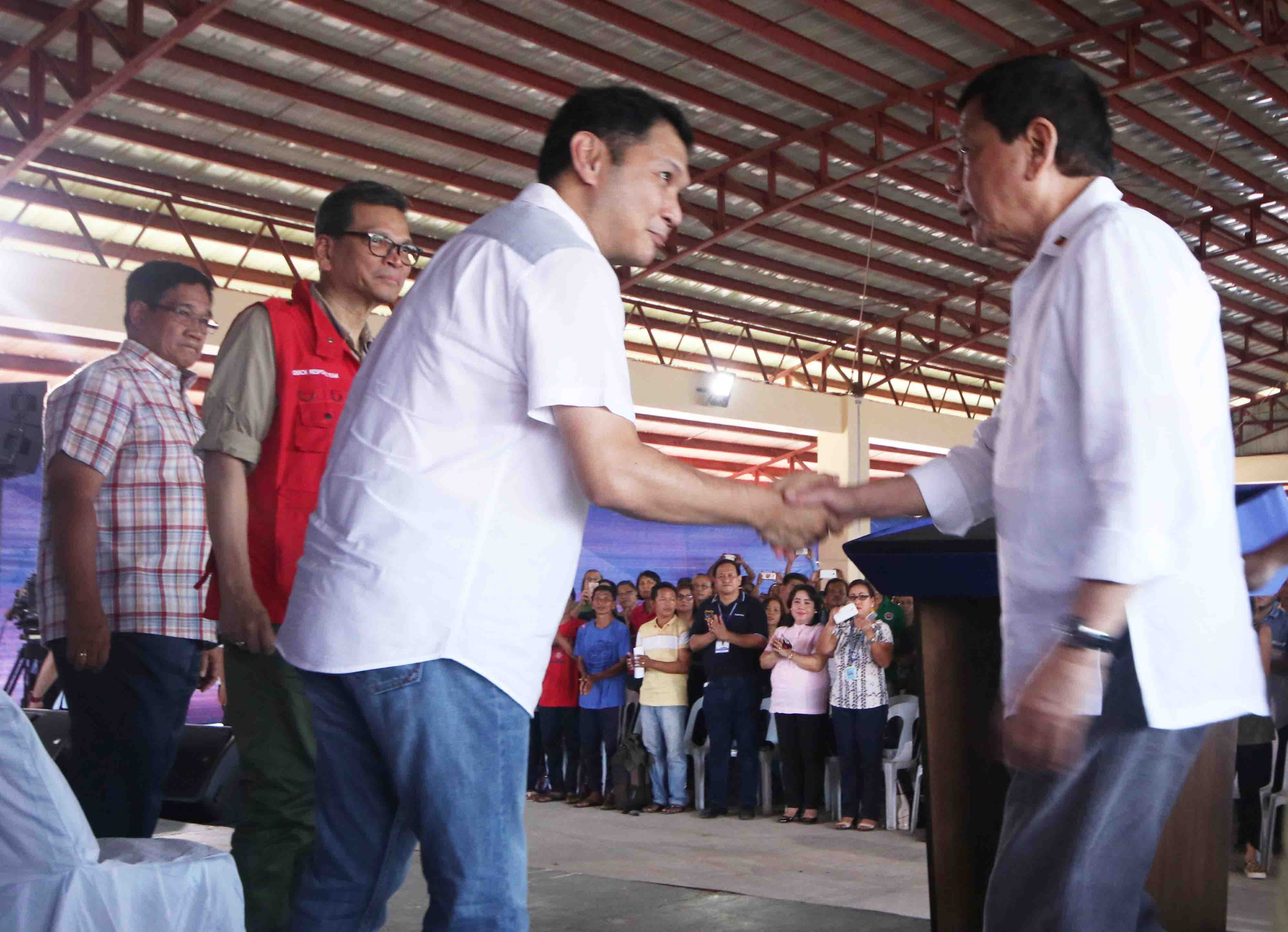 Governor Pogi Espino welcomes President Duterte during the send-off ceremony for Vietnamese Fishermen
